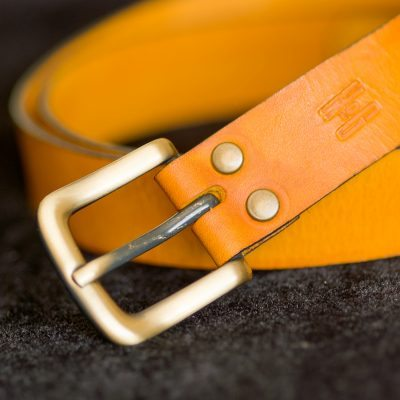 25mm belt. hand cut, dyed in yellow with black sides & brass hardware