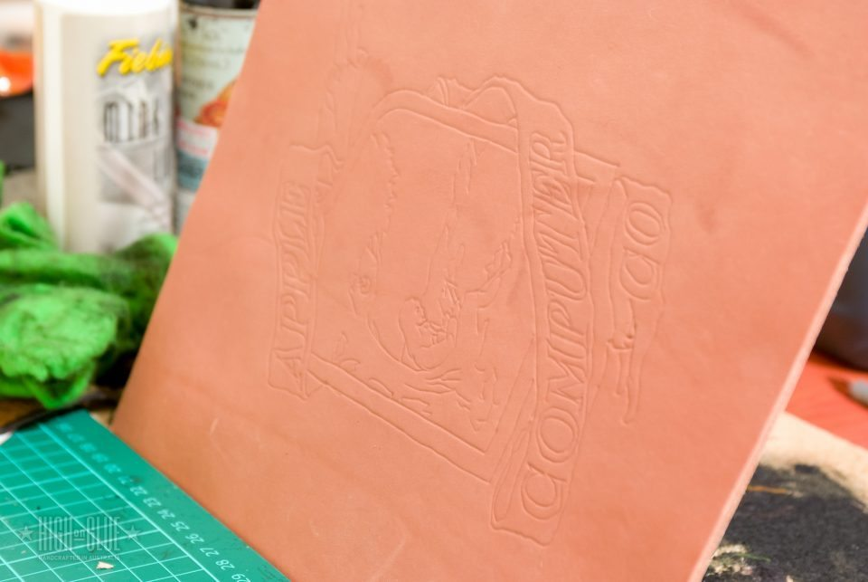 Start out by printing out the design you want to transfer to the leather. Moisten the leather using a sponge and let it sit for a few minutes until the surface is soft. You can place the printout on the leather and trace it using a modeler. If you decide to lift the paper to check if it transfers correctly, make sure the whole image is aligned properly when you put it back down!Note: depending on the type of paper you use, it might tear when you trace it because of the moisture in the leather - so be careful not to apply too much pressure.
