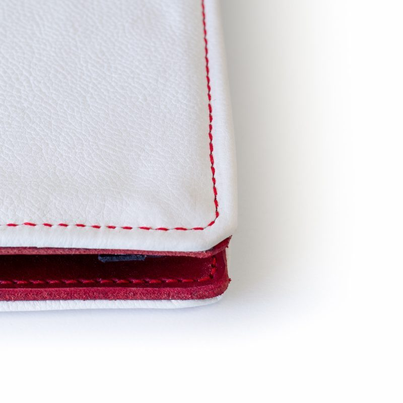 White leather on the outside. This kind of leather is usually used for large bags and has a very soft feel.